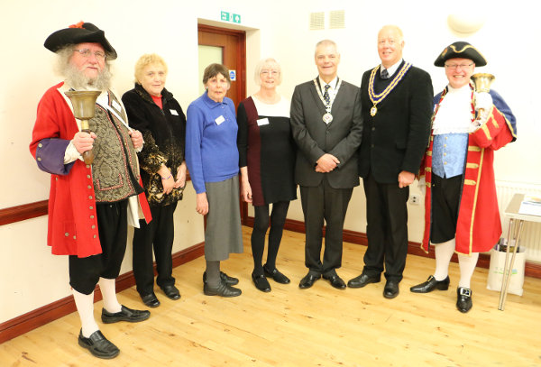 Photograph showing Town Mayors of Wymondham and Attleborough, two Town Criers dressed in regalia nad carrying bells, with Talking Newspaper Volunteers.,